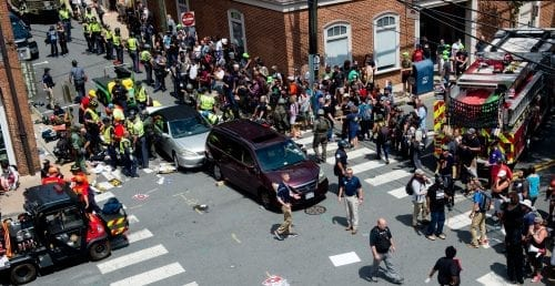 People receive first-aid after a car accident ran into a crowd of protesters in Charlottesville, VA on August 12, 2017. A vehicle plowed into a crowd of people Saturday at a Virginia rally where violence erupted between white nationalist demonstrators and counter-protesters, witnesses said, causing an unclear number of injuries. / AFP PHOTO / PAUL J. RICHARDS (Photo credit should read PAUL J. RICHARDS/AFP/Getty Images)