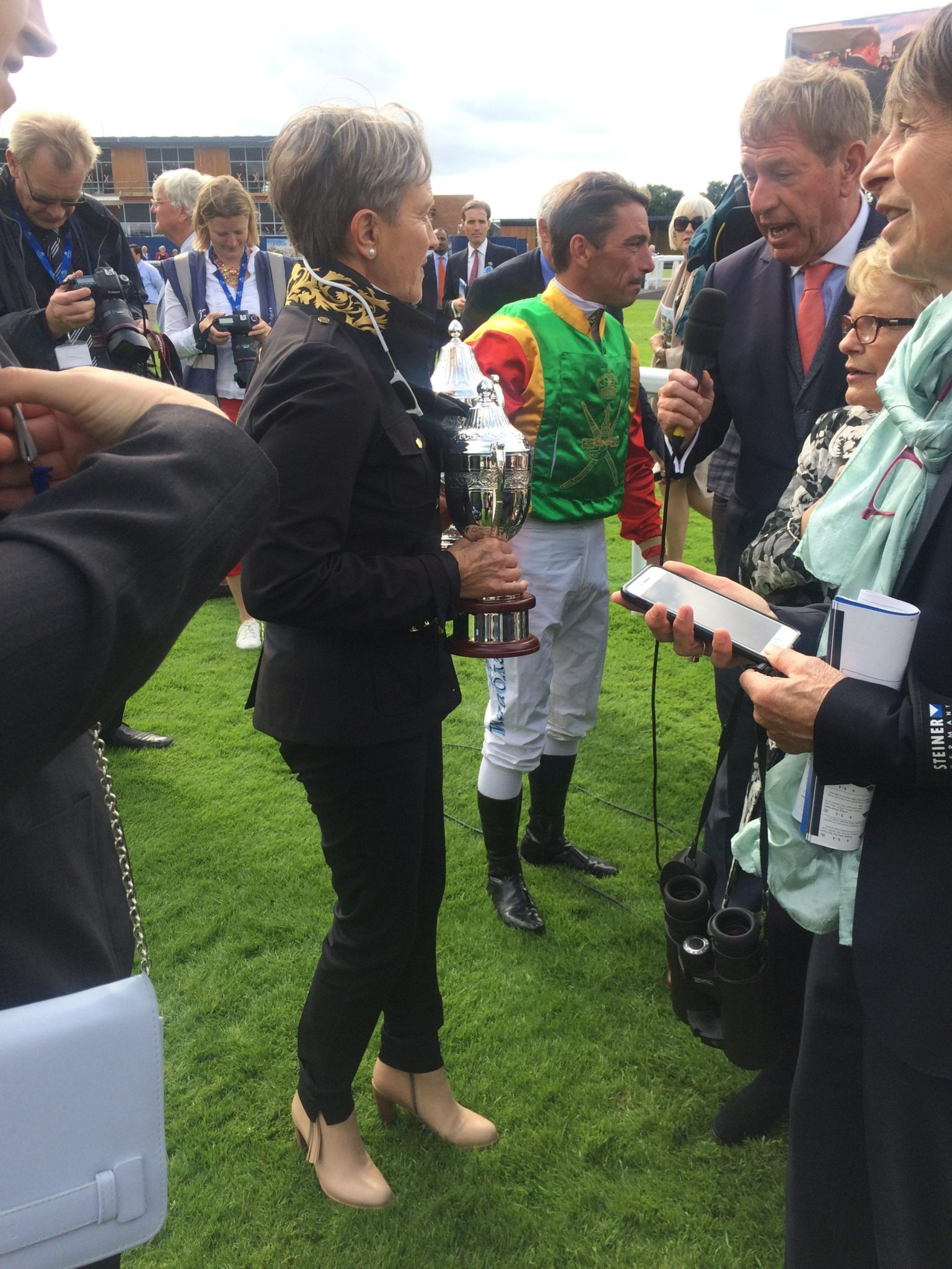 rabian race horse coach Elisabeth Bernard and jockey Jean-Bernard Eyquem being interviewed by renowned commentator Derek Thompson. Courtesy © Nabila Ramdani.